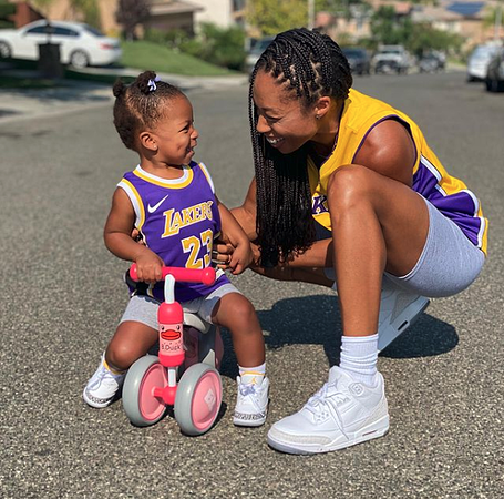 Allyson Felix playing with her daughter