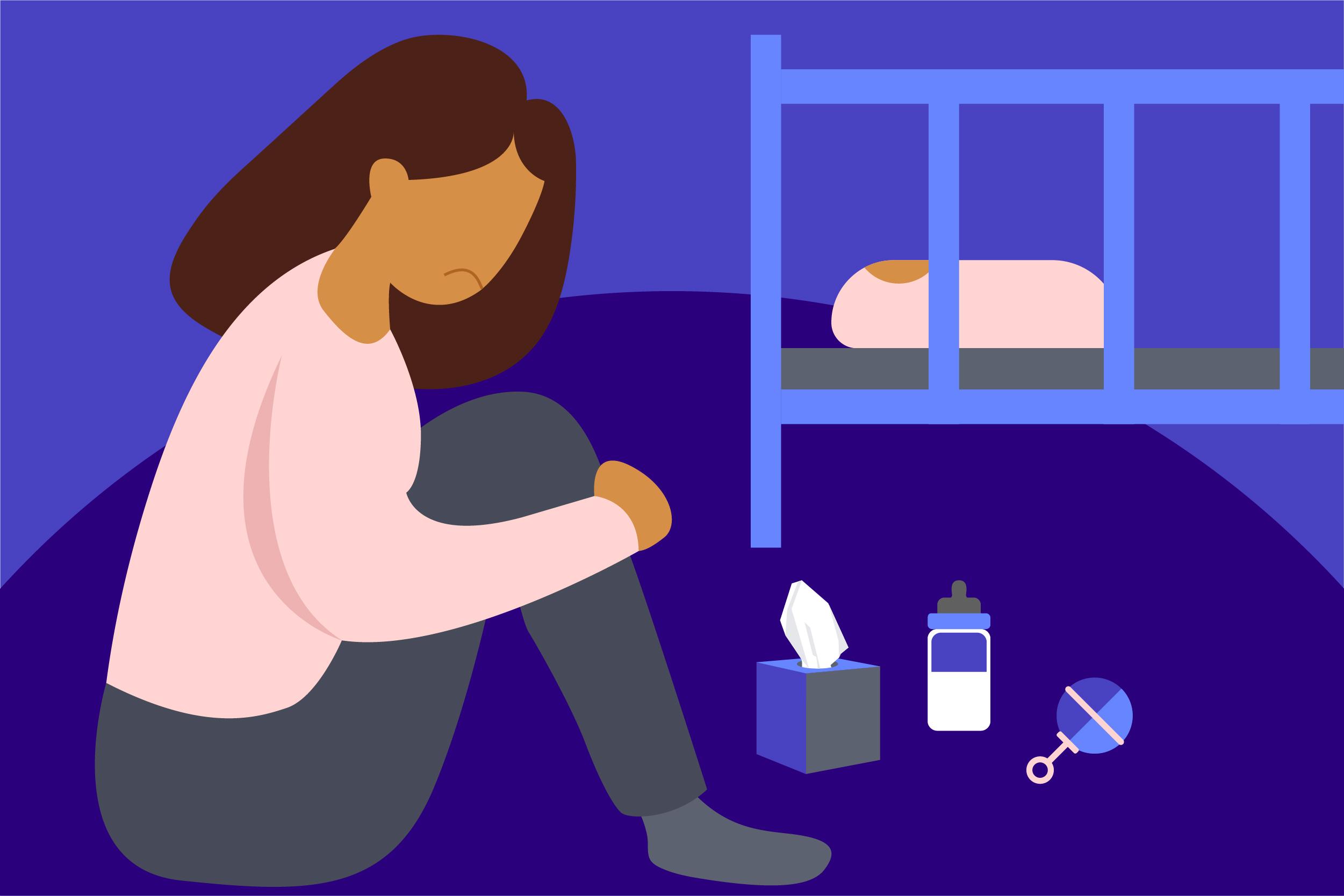 Woman sitting by a crib